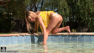 Blonde takes a dip and then takes a dip under he suit to rub clit