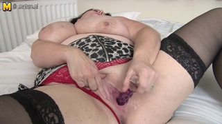 British housewife loves playing with her huge boobs
