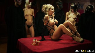 Cute whore is humped by the gigantic joy-stick on the red table