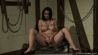 Babe tied with ropes sucks her master off as she works on her cunt