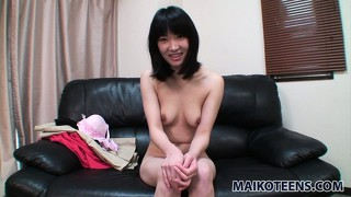 Pretty asian girl makoto puts on display her nice tits, sexy legs and her hairy pussy