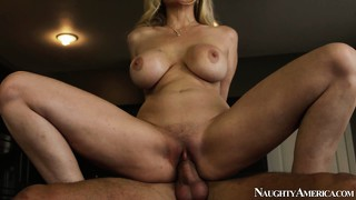 Seated on top of a hard cock, blond cougar is riding it like there's no tomorrow