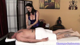 After massaging this horny dude's body she grabs his meat pole and plays with it