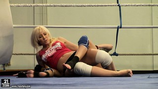 Backstage look at a pair of naughty lesbian bitches wrestling