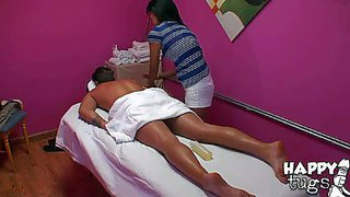 Petite black haired asian doll with tight ass and natural boobies in white hot pants gives arousing massage to young dude with cheep arm tattoo while hidden camera films everything