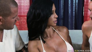Busty brunette milf hottie takes on two cocks with her mouth