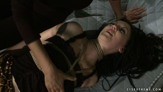 Brunette in bondage in the hospital ward gets a visit from her mistress