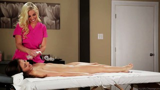 Brunette feels her body warm up as her masseuse gets to work