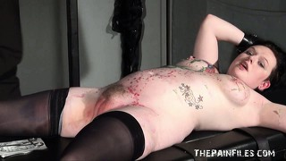 Punishment rack bondage of tattooed amateur slavegirl in hardcore bdsm and extreme piercing pain