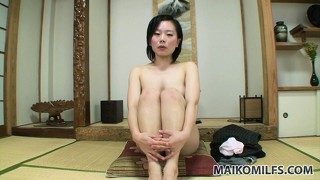 Sultry asian lady with pretty natural tits drops her dress and reveals her hairy pussy