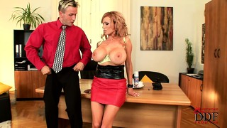 Chubby blonde babe with massive tits plays with her boss' dick