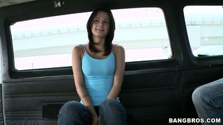 Cute little brunette sits in a van waiting for something to happen