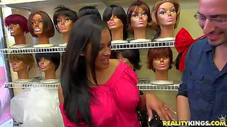 Gorgeous and stunning brunette milf with firm breasts enjoys in teasing in a wig shop and finally shows both her sexy booty and her big hooters in public for the cam
