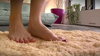Ashley fires posing and demonstrating her hot feet