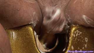Divine brunette with a marvelous ass and alluring tits is a skillful massage expert