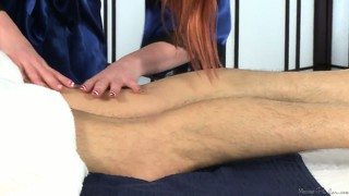 Redhead masseuse with nice tits rubs and then eats his boner