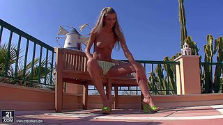 Dominique gets her outdoor masturbation session started topless. leggy babe with natural tits pulls her panties aside and makes her fingers disappear in her love hole. watch her play with her love hole in the sun.