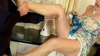 Naughty granny gets fucked in the kitchen