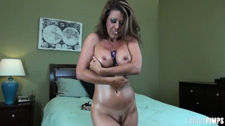 Busty cougar fucks herself like crazy during a hardcore show