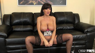 Fit cougar with gigantic tits clad in lingerie rubs her pussy