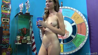 She takes a break and has a drink, posing and showing her body