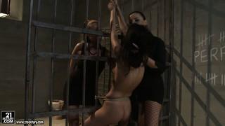 She's naked and tied to the bars and gets clothespin tortured