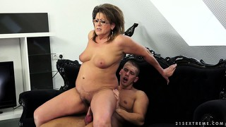 The fat mature babe gets her hairy cunt pounded all over the sofa and loves it