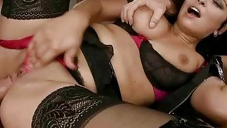 Gorgeous brunette enjoys two cocks