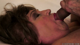 Brunette margitta with massive breasts drops on her knees to gives headjob to handsome guy