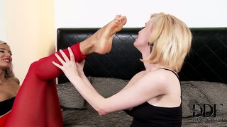 Two babes in a foot fetish are sucking and licking their toes