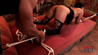 Sexy brunette babe bound with ropes gets teased till she's wet