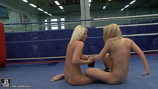 Attractive young slender blonde babes simony diamond and karina shay with nice juicy hooters and tight asses fight naked like wild animals on the floor in ring while referee is filming them