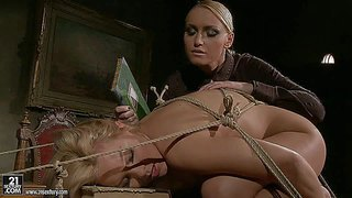 Salome is a sexy bodied blonde babe who is naked and helpless. she is tied to desk and can't make a move without kathia nobili's help. watch naked girl get humiliated by clothed mistress.