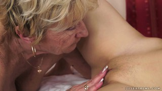 Horny granny goes down on the young thing's twat, then they trib