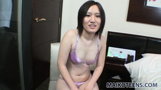 Mina sensually drops her clothes and shows off her tiny boobs and her sweet hairy twat
