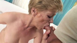 Blonde granny munches his bone and then gets fucked from behind