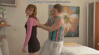 Ginger on massage table with hot squirt
