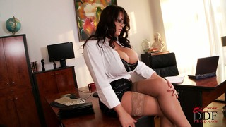 Gorgeous brunette secretary seductively reveals the sexy contours of her curvy body