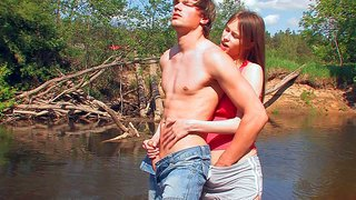 Beata and her boyfriend have sex fun in nature. she unzips guy's jeans and sucks his dick by the lake. then bad girl pulls down her shorts and gets her shaved teen pussy fingered from behind in the long grass.