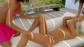 Steaming hot young looking adorable leasbian goddesses with perfect bodies in short skirts and undies make out and have mind blowing wet outdoor threesome filmed in close up