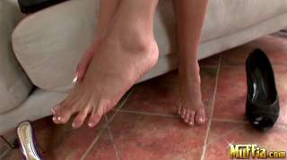 Yoha gets her hot feet massged by a guy