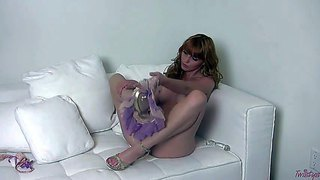 Horny and handsome redhead marie mccray in high heels enjoys in taking her lingerie off and stimulating her hairy pussy on the couch in the living room with her glass dildo