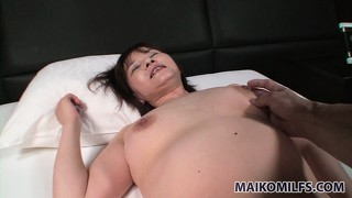 Naughty asian housewife gets freaky with a massive pink dildo
