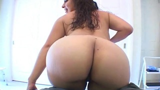 Wavy-haired brunette with big ass plays with a toy
