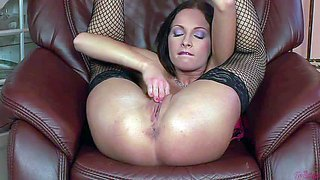 Passionate brunette lauryn may in black mesh stockings and shoes lifts her legs up and inserts her fingers in her love tunnel. she enjoys deep pussy fingering right in front of the camera.
