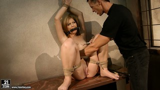 She's tied up and gagged and he spanks and tortures her and makes her masturbate
