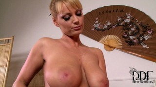 Oiled up busty blonde is ready to rub and does sixty-nine and tit job