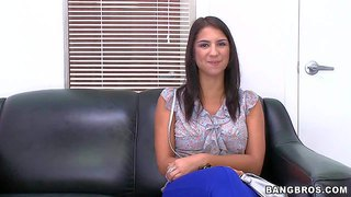 Tanned and slim brunette babe evi fox with a nice tattoo on her shoulder enjoys in giving an interview and showing her sexy ass on the black leather couch