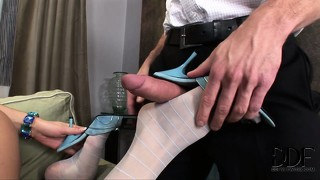 Horny and lustful, the sexy blonde displays her amazing blowjob and footjob skills