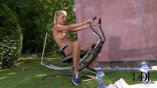 Sweet blonde holly anderson aka holly pearce does exercise topless in the garden. she shows off her mouth-watering perky boobs before she takes off her shorts to rub her hairless pussy.